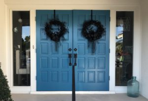 Funeral wreaths on our door signify that this house is in mourning